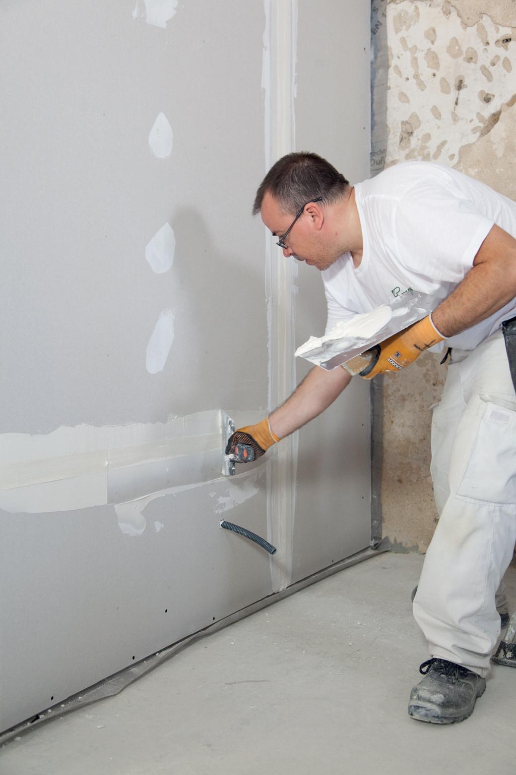 Poser un calicot entre deux plaques de plâtre