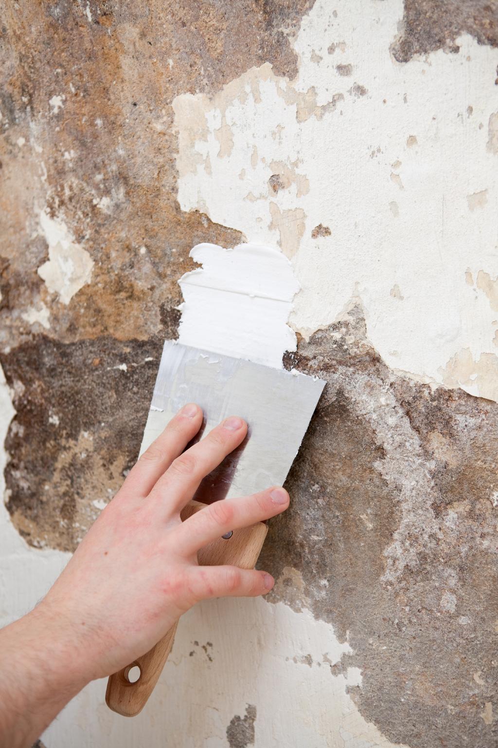 Réparer un mur de cave