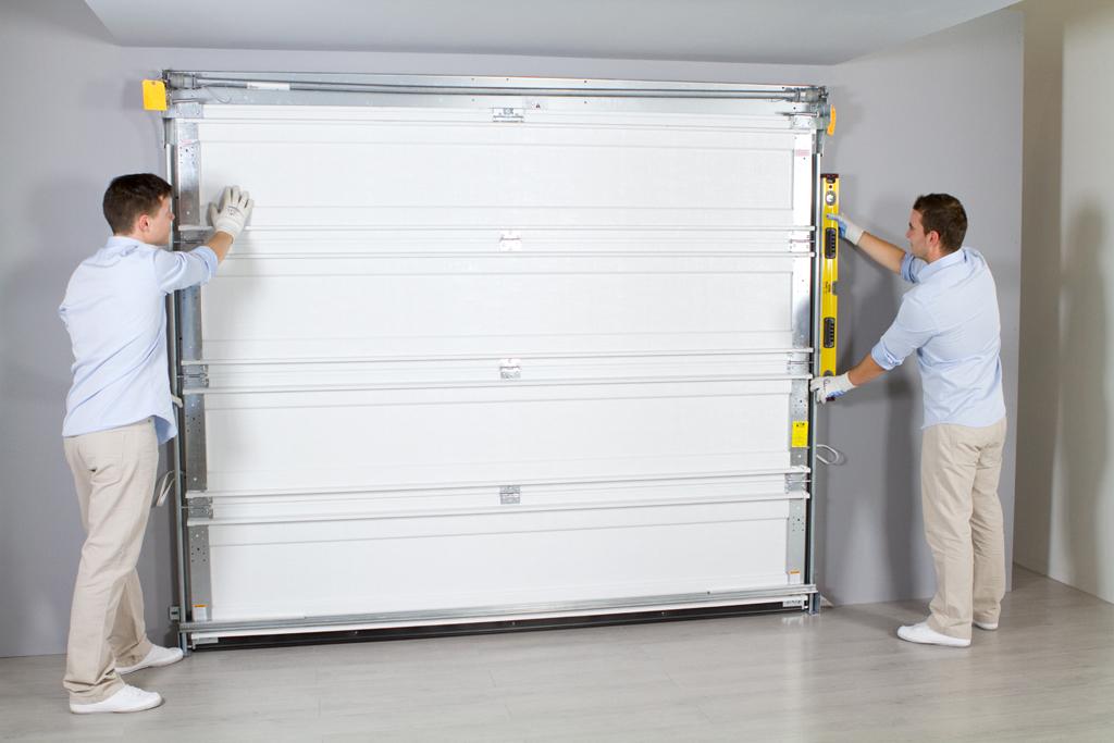 installer une porte de garage diy family. Black Bedroom Furniture Sets. Home Design Ideas