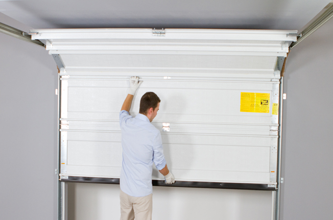 Installer une porte de garage diy family - Installer une porte de garage sectionnelle ...